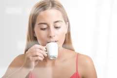 Woman Drinking an Espresso At a Coffee Shop Royalty Free Stock Image