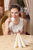 Woman drinking espresso in a restaurant Royalty Free Stock Photo