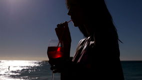 Woman drinking an exotic cocktail stock video footage
