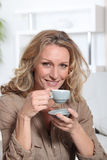Woman drinking an expresso Royalty Free Stock Images