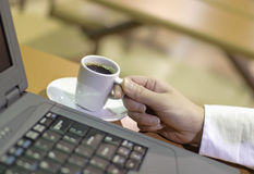 Woman drinking an expresso coffee Royalty Free Stock Photography