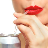 Woman drinking fizzy. From straw Stock Photo