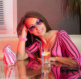 Woman drinking fresh cocktail. Pretty woman drinking cocktail in nightclub Stock Photography