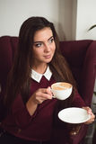 Woman drinking fresh coffee. Stock Photography