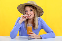 Woman drinking fresh juice Stock Photography