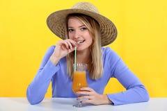 Woman drinking fresh juice Stock Photography