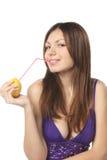 Woman drinking fresh lemon juice Royalty Free Stock Image