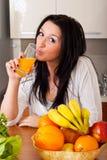 Woman drinking fresh orange juice Royalty Free Stock Photo