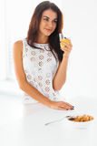 Woman drinking fresh orange juice and eating breakfast. Happines Stock Photo