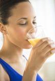 Woman Drinking Fresh Orange Juice At Gym Royalty Free Stock Photos