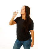 Woman drinking fresh water from bottle Stock Photo