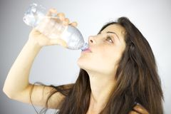 Woman drinking fresh water Royalty Free Stock Image