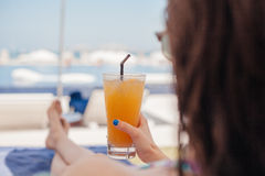 Woman In Drinking Fruit Cocktail At The Beach Royalty Free Stock Photos
