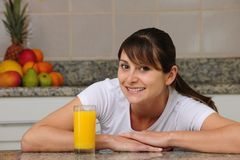 Woman drinking fruit juice Stock Photos