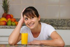 Woman drinking fruit juice Stock Image