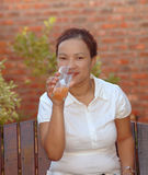 Woman drinking healthy fruit juice royalty free stock photos