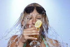 Woman is drinking Stock Images