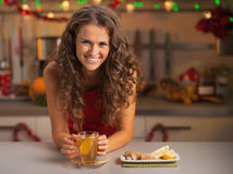 Woman drinking ginger tea in christmas decorated kitchen Royalty Free Stock Photography