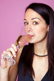 Woman drinking a glass of champagne Royalty Free Stock Photo