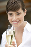 A woman drinking a glass of champagne Stock Images