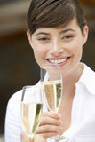 A woman drinking a glass of champagne Royalty Free Stock Image