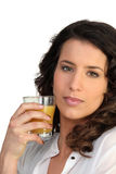 Woman drinking a glass juice Royalty Free Stock Image