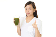 Woman drinking a glass of juice Stock Image