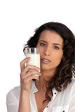 Woman drinking a glass of milk Royalty Free Stock Photography