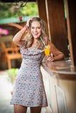 Woman drinking glass orange juice Stock Photography