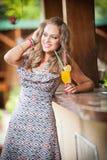 Woman drinking glass orange juice Stock Images