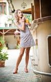 Woman drinking glass orange juice Stock Image