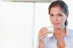 Woman drinking a glass of water Stock Photos