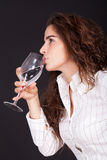 Woman drinking a glass of water Stock Images