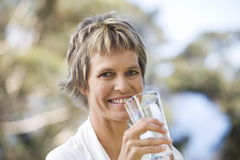 Woman drinking a glass of water Royalty Free Stock Images