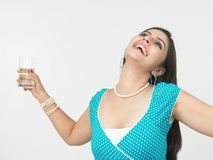 Woman drinking a glass of water Stock Photography