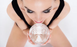 Woman drinking glass of water Royalty Free Stock Photos