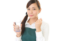 Woman drinking a glass of water Stock Photo