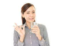 Woman drinking a glass of water Royalty Free Stock Photography