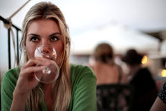 Woman drinking a glass of wine Royalty Free Stock Image