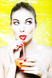 Woman drinking grapefruit juice Stock Photography