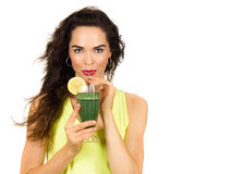 Woman drinking a green smoothie. Beautiful healthy woman drinking an organic green smoothie. Isolated on white stock images