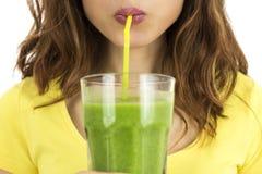 Woman drinking green smoothie stock photos
