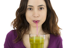 Woman drinking green vegetable juice Stock Photography