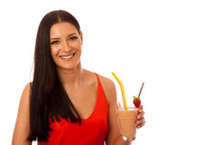 Woman drinking healthy fresh fruit smoothie decorated with red s Royalty Free Stock Photography