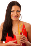 Woman drinking healthy fresh fruit smoothie decorated with red s Royalty Free Stock Photo