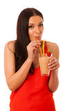 Woman drinking healthy fresh fruit smoothie decorated with red s Stock Photo