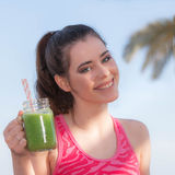 Woman drinking healthy smoothie Royalty Free Stock Images