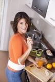 Woman drinking her orange juice Stock Image
