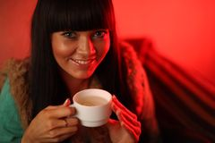 Woman drinking herb tea. Smiling woman drinking herb tea stock photos