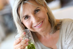 Woman drinking herbal infusion Royalty Free Stock Photography